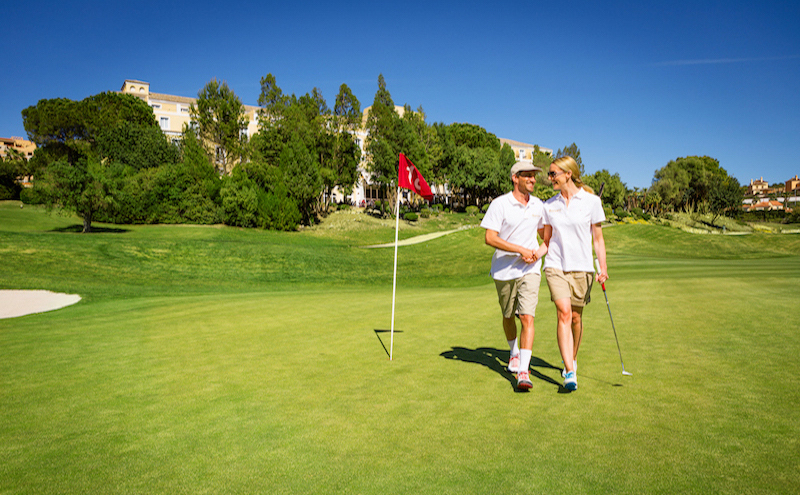Happy couple exiting the 18th hole at Montecastillo Golf, Spain